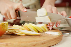 Female hands slicing apple Royalty Free Stock Image