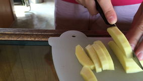 Female hands slicing mango, dolly shot stock footage