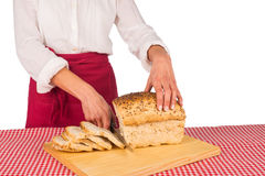 Slicing bread Stock Photography