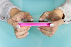 Female hands on smartphone Stock Photography