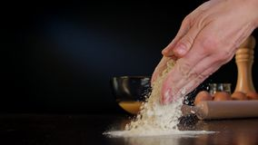 Female Hands Spilling Flour on the Table Stock Images