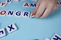 Hands spread letters Stock Photos