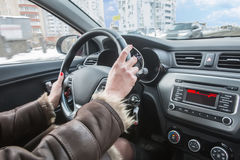 Female hands on the steering wheel of car Stock Photo