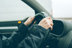 Female hands on steering wheel Royalty Free Stock Image