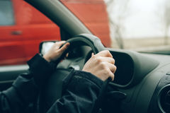 Female hands on steering wheel Royalty Free Stock Photo