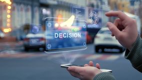 Female hands interact HUD hologram with text Decision. Female hands on the street interact with a HUD hologram with text Decision. Woman uses the holographic stock footage