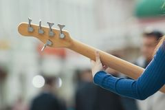 Female hands of street musician playing guitar. Close up Royalty Free Stock Photo