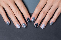 Female hands with a stylish neutral manicure Stock Images