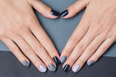Female hands with a stylish neutral manicure Royalty Free Stock Image