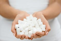 Female Hands With Sugar Cubes. Close Up Of Woman`s Hands With White Sugar. High Quality stock images