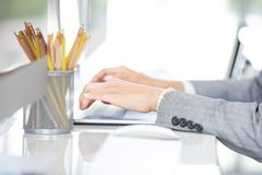 Female hands in suit working use computer on the white table in stock image