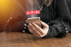 Young woman hands using smartphone with Instagram icons communication concept . Young woman hands using smartphone with Instagram icons communication concept Royalty Free Stock Photography