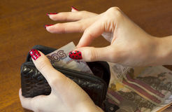 Female hands take money out of the purse Stock Photography