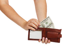 Female hands take out a hundred dollar bill from his wallet Royalty Free Stock Images