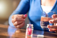 Female hands taking medication Royalty Free Stock Photo