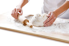 Female hands taking rolling pin for making dough on board Royalty Free Stock Photos
