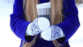 Female hands with thermal coffee mug in winter day stock video
