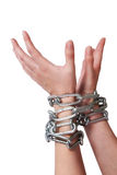 Female hands tied by chain isolated Stock Images