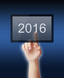 2016 On. Female hands touch a tablet pad computer with year 2016. Can be also used for review of the year 2016 Royalty Free Stock Images