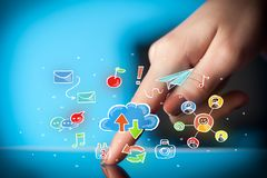 Fingers touching tablet with social icons. Female hands touching tablet with colorful social media icons Royalty Free Stock Photo
