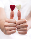 Female hands with toy hearts Stock Photos