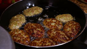 Female Hands Turning Meat Cutlets in a Frying Pan. stock video footage