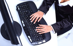 Female hands typing on computer Stock Image