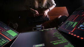 Female hands typing computer code, hacking computer at a dark room. Hacker, programmer at work. stock video footage