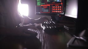 Female hands typing computer code, hacking computer at a dark room. Hacker, programmer at work. stock footage