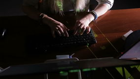 Female hands typing computer code, hacking computer at a dark room. Hacker, programmer at work. stock video