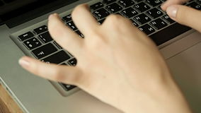 Female hands typing on computer keyboard. Close up stock video footage