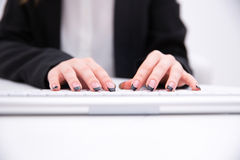 Female hands typing on computer keyboard Stock Photography