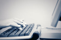 Female hands typing on computer keyboard. At office royalty free stock photo