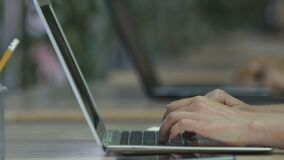 Female hands typing email on laptop keyboard, businesswoman working at office. Stock footage stock video footage