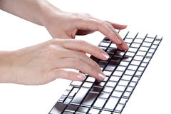 Female hands typing (isolated) Royalty Free Stock Photos