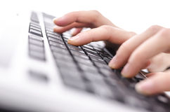 Female hands typing on keyboard Royalty Free Stock Photo