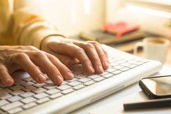 Female hands typing on a keyboard. Education. Female hands typing on a keyboard royalty free stock image