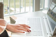 Female hands typing on keyboard Royalty Free Stock Image