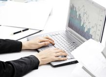 Female hands typing on the keyboard and while holding the mouse. Analysis of the graphs of sales stock photos
