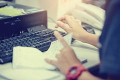 Female hands typing keyboard for input data. Technology concept about input data and process it stock photography