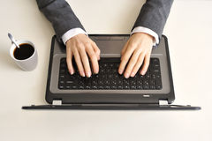 Female hands typing on a keyboard. A little blur of moving by the hands bringing some action to this photo Royalty Free Stock Photo