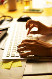 Female hands typing on the keyboard. At the office stock photo