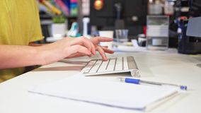 Female hands typing on a keyboard in the Office stock video footage