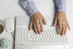Female hands typing on keyboard, white computer Royalty Free Stock Photo