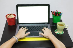 Female hands typing on keyboard of white isolated screen laptop stock photos