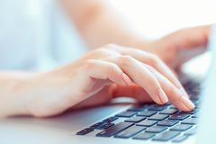 Female hands typing on the keyboard Stock Photos