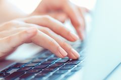 Female hands typing on the keyboard Stock Images