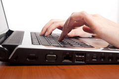 Female hands typing on a laptop Stock Image