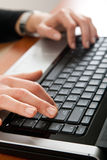Female hands typing on a laptop Stock Photo