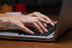 Female hands typing on a laptop Royalty Free Stock Image